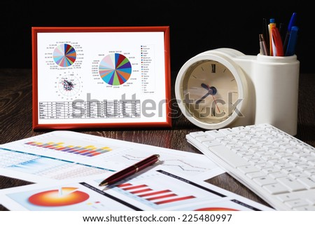 Close up of office workplace with paper documents - stock photo