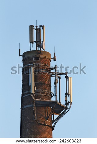 Close up of old chimney used as a base for radio transmitters. - stock photo