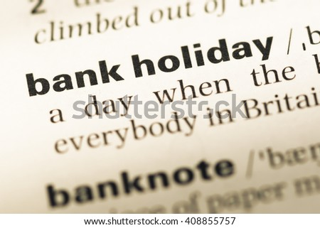Close up of old English dictionary page with word bank holiday - stock photo