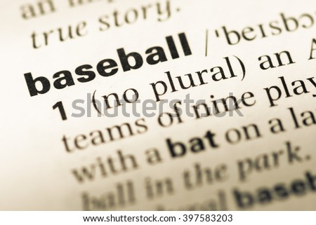 Close up of old English dictionary page with word baseball - stock photo