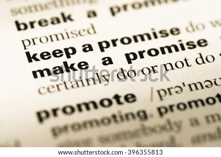 Close up of old English dictionary page with word keep a promise - stock photo