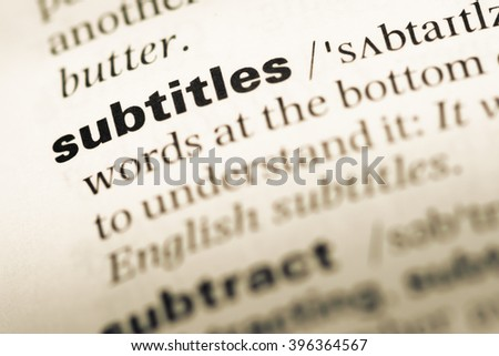 Close up of old English dictionary page with word subtitles - stock photo