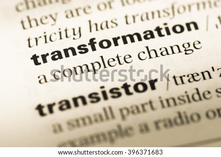 Close up of old English dictionary page with word transformation - stock photo