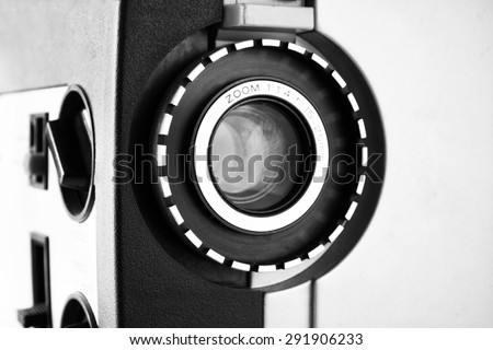 close up of old 8mm Film Projector lens. black and white photo  - stock photo