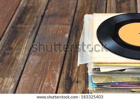 close up of old record and records stack. room for text. - stock photo