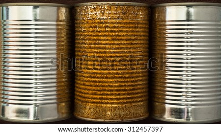 close-up of old rusty and clean new food container tin cans - stock photo