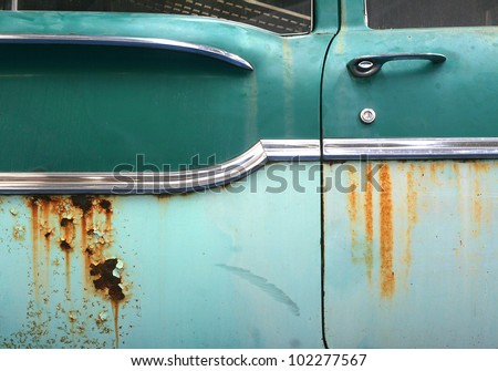 Close up of old rusty car door with space for your text - stock photo