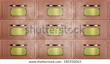 Close up of old wooden card catalogue front view with golden labels nailed by white metal screws - stock photo