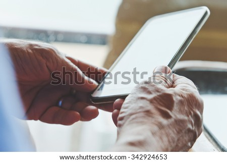 Close up of older man checking his phone background - stock photo