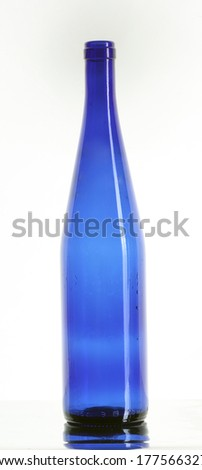 close-up of one empty bottle blue color without cork isolated on white background studio - stock photo