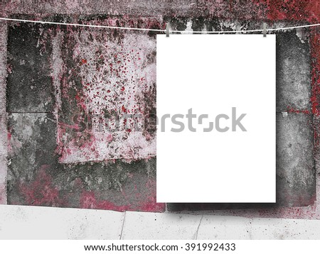 Close-up of one hanged blank frame with pegs against scratched painted wall background - stock photo