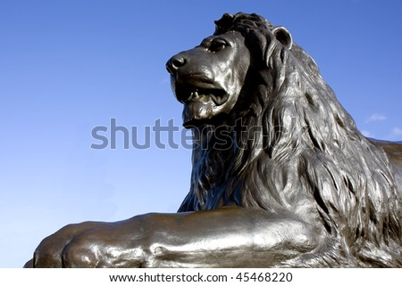 Close up of one of the bronze lions at Trafalgar Square, London, England. - stock photo