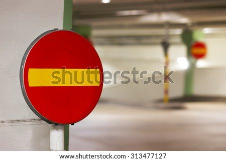 Close up of one way sign in parking garage - stock photo