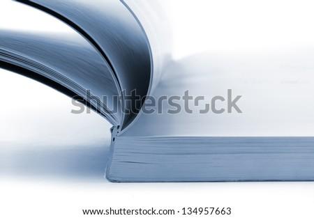 Close up of open catalog on white background - stock photo