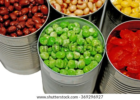 Close up of opened cans of vegetables - stock photo