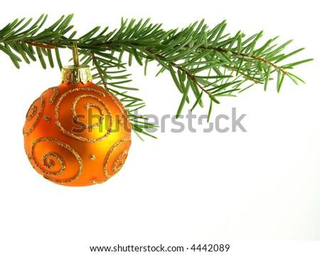 Close-up of orange Christmas bauble on tree against white background - stock photo