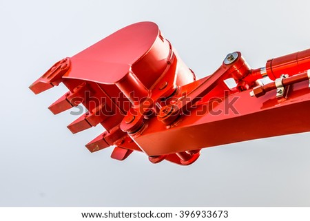 close up of orange excavator bucket - stock photo