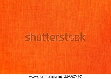close up of orange felt fabric, orange background - stock photo