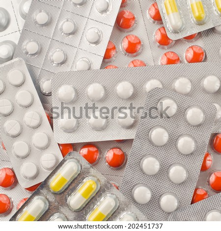 Close up of packs of pills and capsules   - stock photo