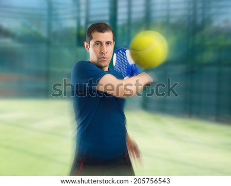 close up of paddle tennis player in zoom effect - stock photo