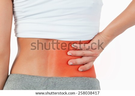 Close up of painful female back against a white background - stock photo