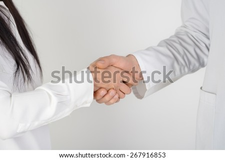 Close up of patient shaking hands with doctor - stock photo