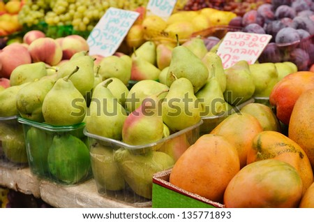 close up of pears and other fruits on market stand in Israel - stock photo