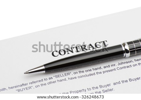 Close-up of pen on contract - stock photo