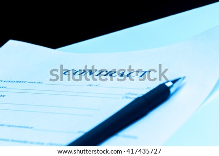 Close-up of pen on contract. - stock photo