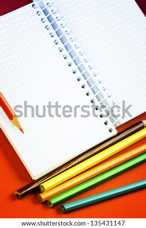 Close-up of pencil and agenda - stock photo