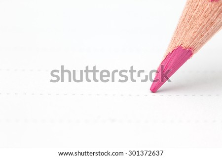 Close up of pencil writing on paper. Macro with extremely shallow depth of field - stock photo