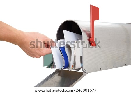 Close-up Of Person's Hand Taking Letter From Mailbox Against White Background - stock photo