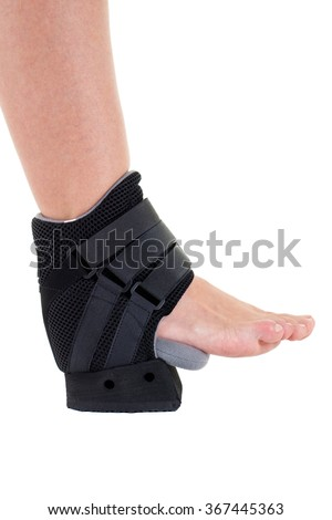 Close Up of Person with Foot and Ankle Wrapped in Modern Cast Secured with Velcro Straps in Studio with White Background with Copy Space - stock photo