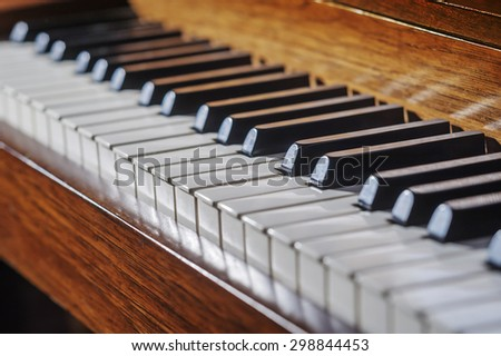 Close up of piano keys with very limited depth of field - stock photo