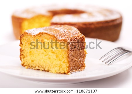 close up of piece of cake with icing sugar - stock photo