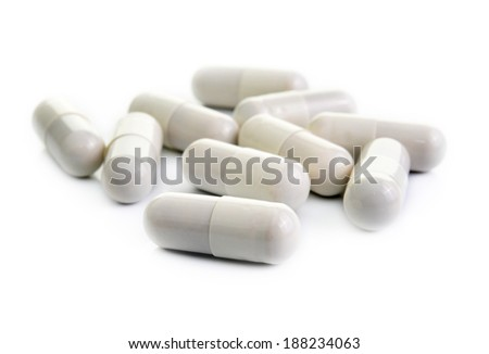 close up of pills capsule isolated on white background  - stock photo