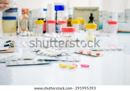 close up of pills with other medicines on background - stock photo