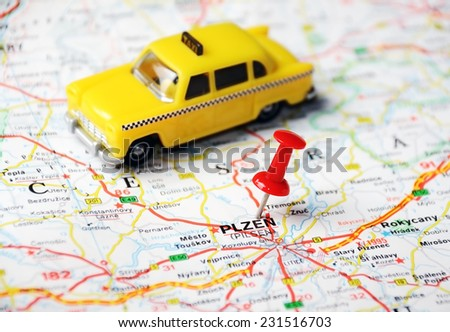 Close up of  Pilsen, Czech Republic  map with red pin and a taxi  - Travel concept - stock photo