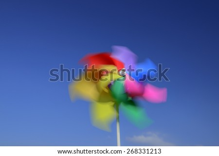 Close up of  pinwheel against  blue sky - stock photo