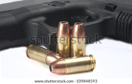 Close up of pistol and ammuntion on white background - stock photo