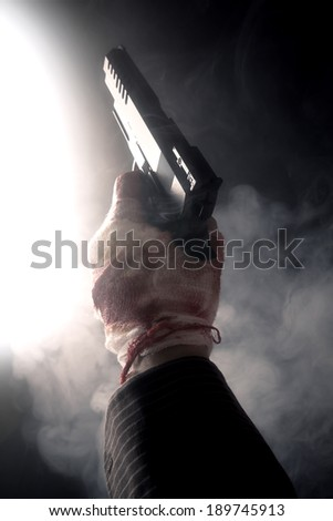 close-up of pistol in smoke - stock photo