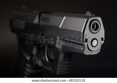Close Up of pistol on black background - stock photo