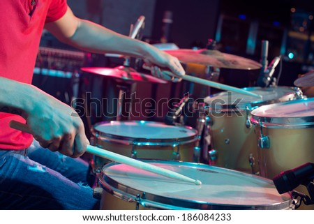 Close-up of playing on drums - stock photo
