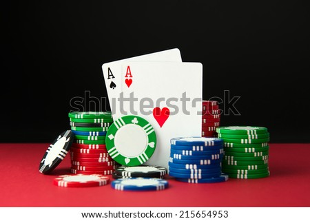 Close up of poker aces and casino chips - stock photo