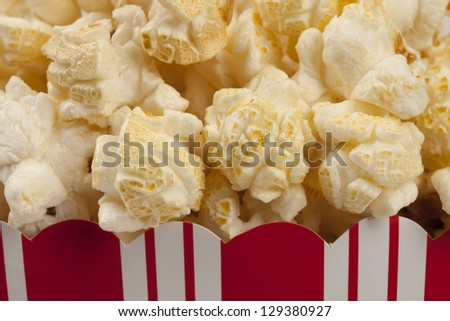 Close up of popcorn in popcorn box. - stock photo