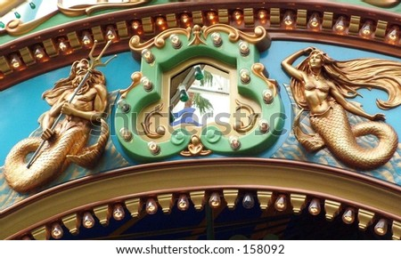 Close up of Poseidon and Mermaid figure on carousel - stock photo