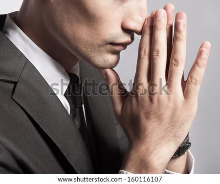 Close up of praying businessman - stock photo