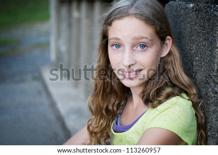 close up of pretty blue eyed teen girl - stock photo