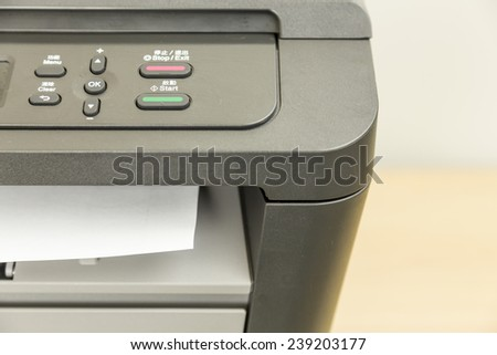 Close-up of printer printing documents on paper - stock photo