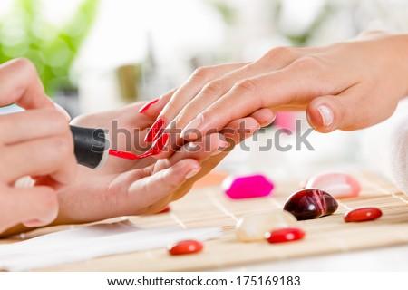 Close up of process of manicure at beauty salon - stock photo